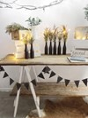Large Trestle Table, Wooden Bunting and Matte Black Bottles with Feather Grass Hollow Furniture
