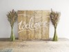 "Wooden ""Welcome"" Sign and Wildflowers on Large Trestle Table Hollow Furniture"