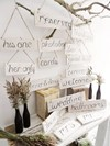 Wooden Hanging Signs and Matte Black Bottles with Feather Grass Bouquets Hollow Furniture