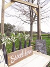 """Sweet Love"" Sign, Matte Black Bottles and Reclaimed Barn Wood Archway Hollow Furniture"